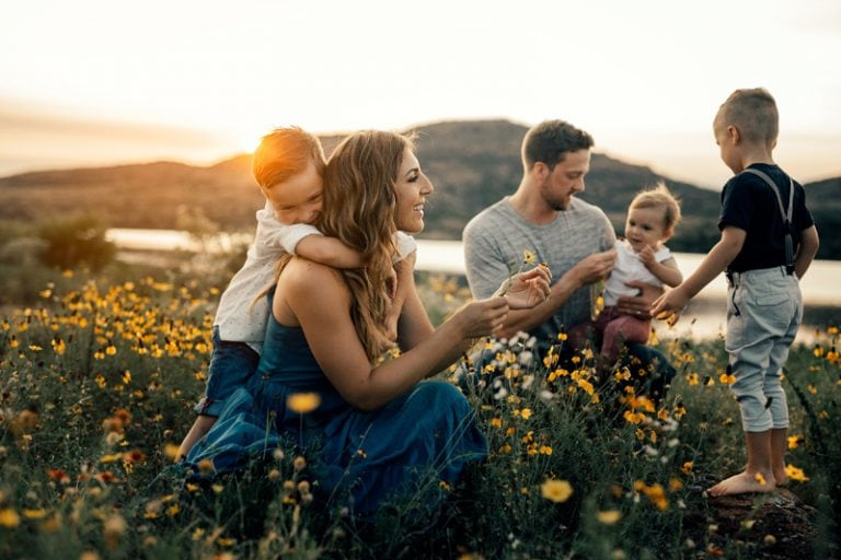 Family Photography, family of five kneeling in a field of yellow flowers