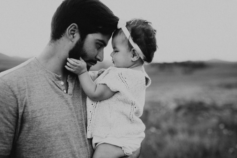 Family Photography, black and white of father and baby daughter sitting forehead to forehead