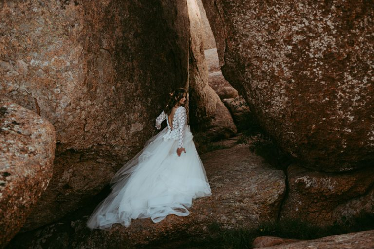 Family Photography, bride posing between two massive boulders