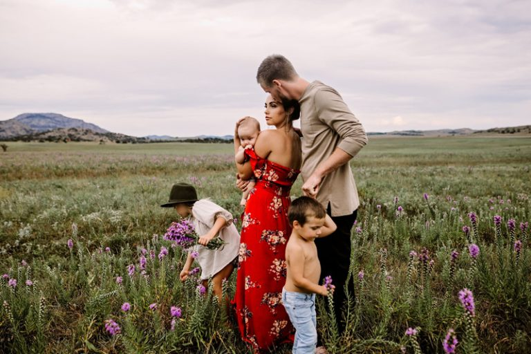 Family Photography, family of 5 standing in a field of purple flowers