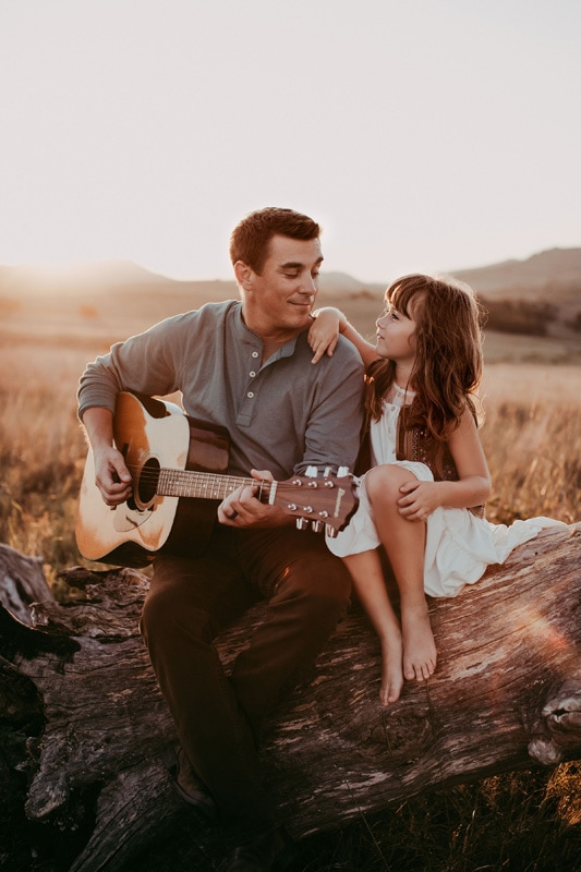 Family Photography, father playing guitar to daughter