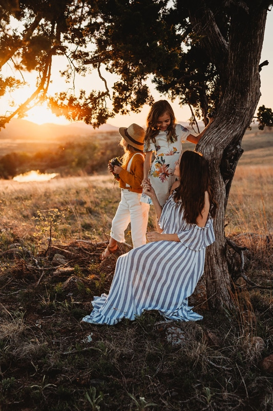 Family Photography, mother and children sitting underneath a tree during sunset
