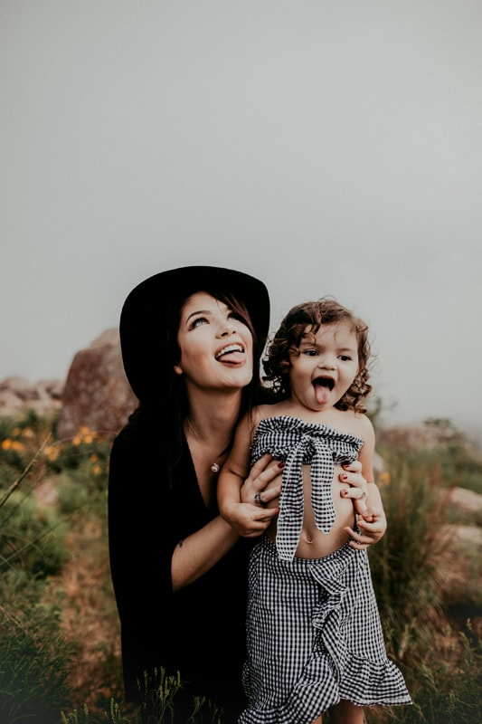 Family Photography, mother and daughter posing together with their tongues out