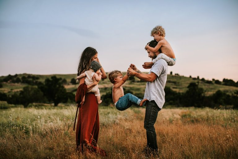 Family Photography. family of 5 playing together in a field