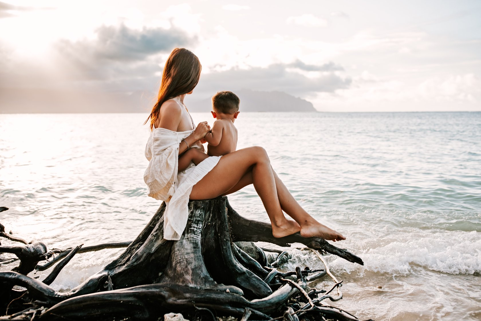 Family Photography. mother and child looking out at the ocean