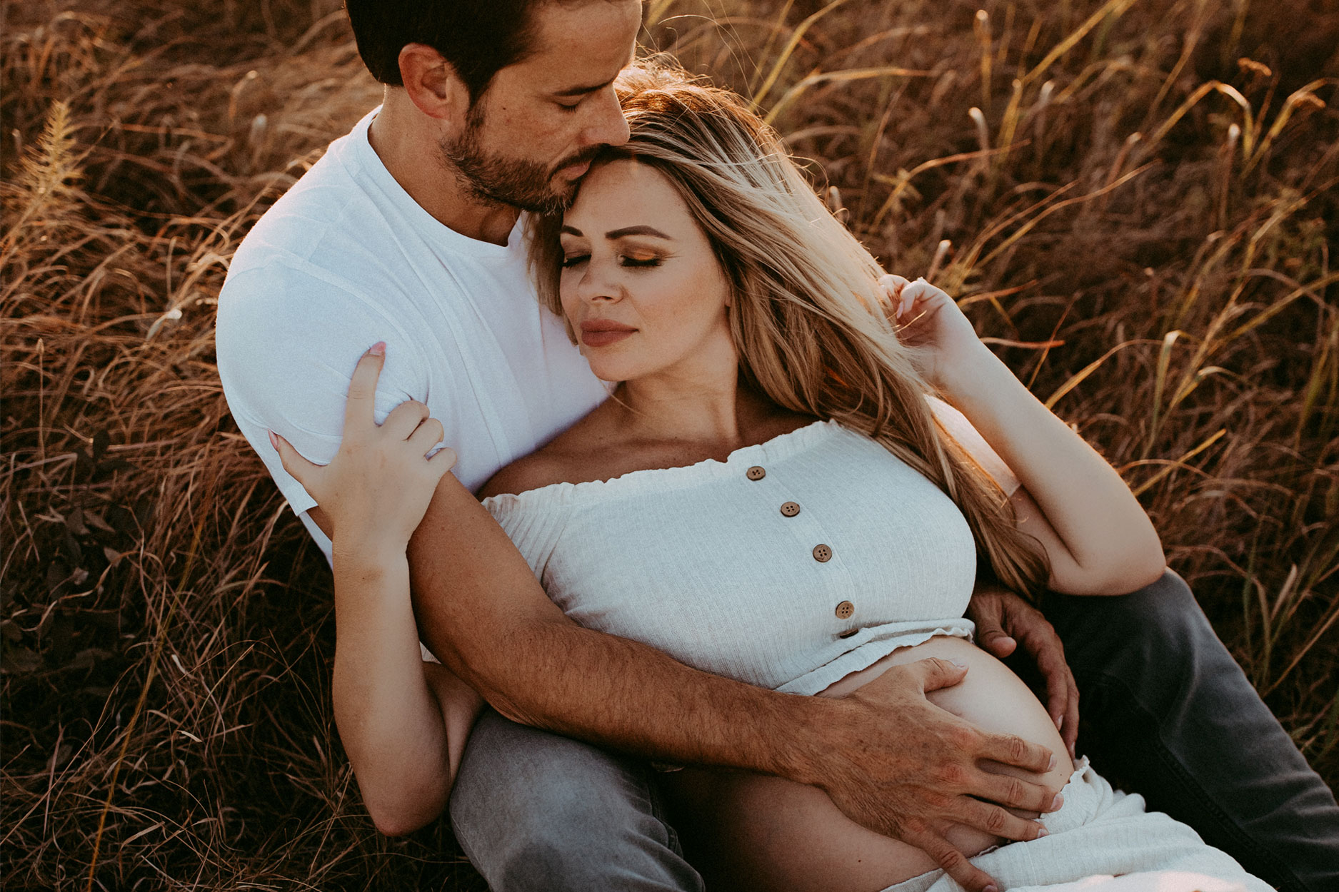 Jacksonville, NC, Family Photographer, woman laying in husband's lap in field