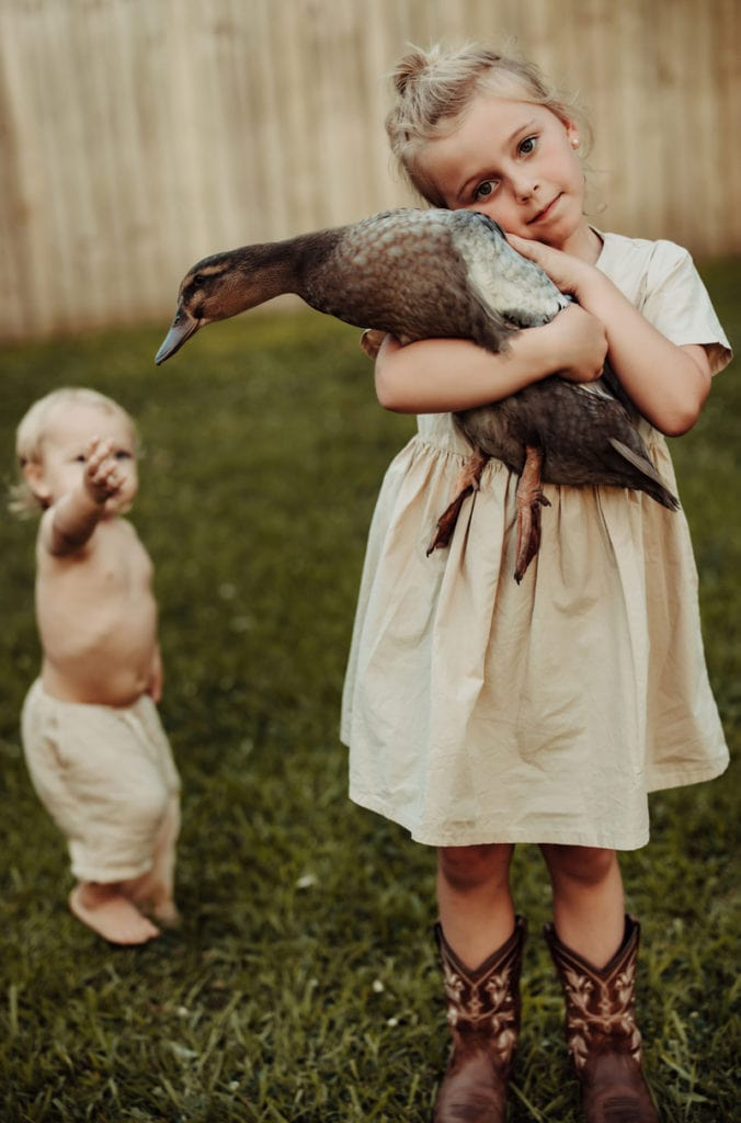 Family Photographer, little girl holding a duck
